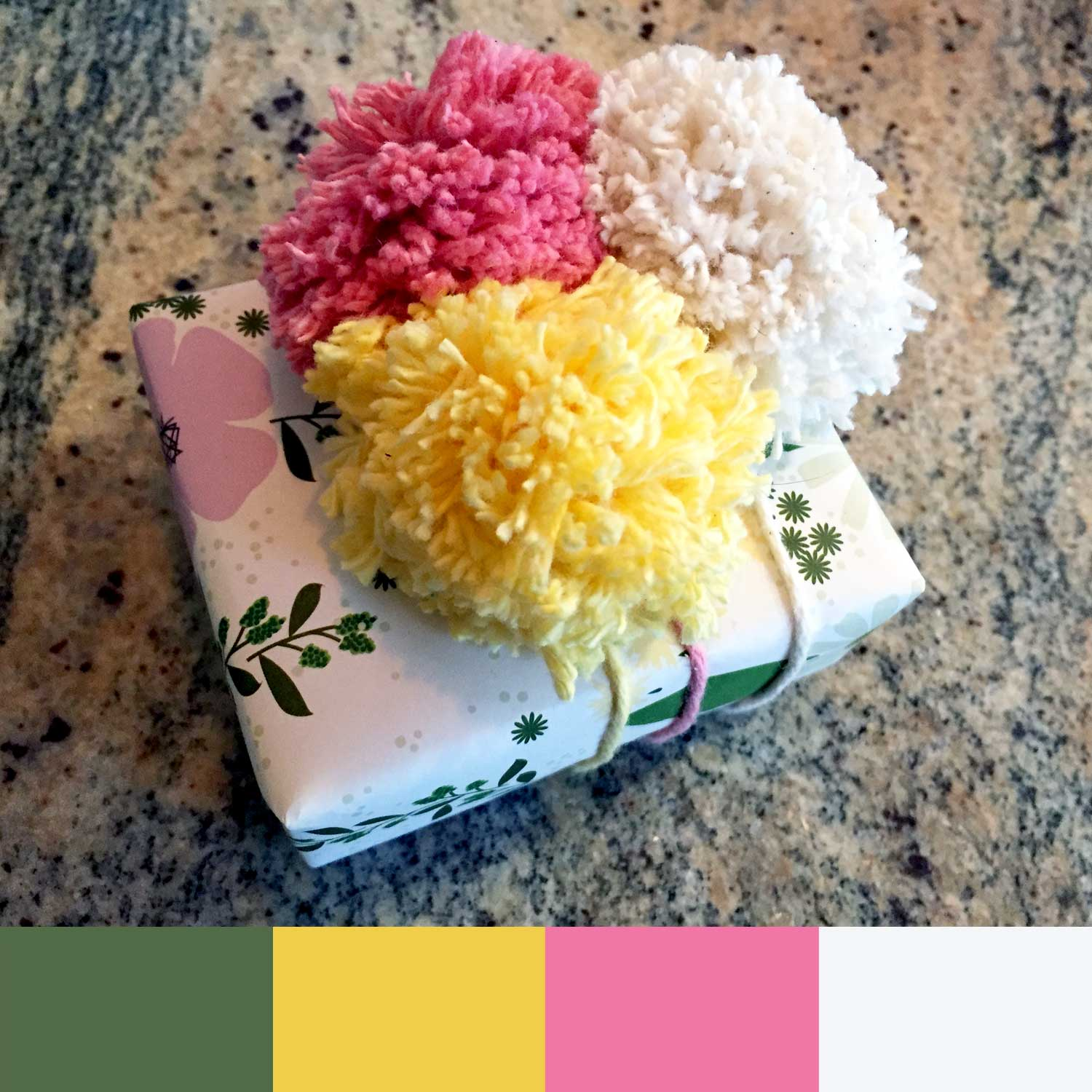 Pom poms make a gift wrap better and inspired this week's happy color palette
